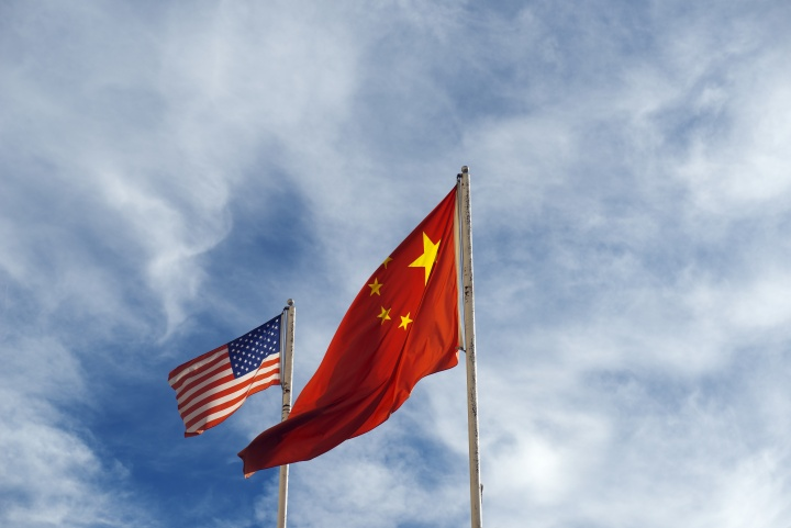 A United States of America and Chinese flag.