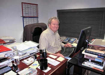 John Ross Schroeder working at his desk.