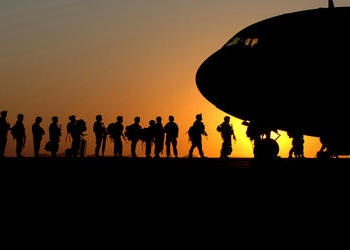 Soldiers boarding an airplane.