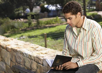 A young man reading the Bible.