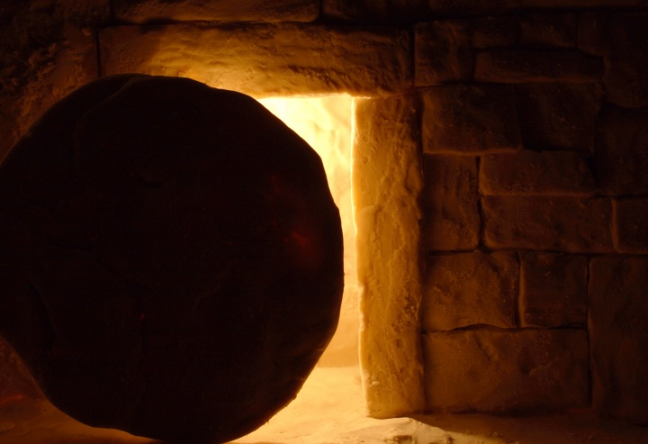 Round stone in front of a tomb.