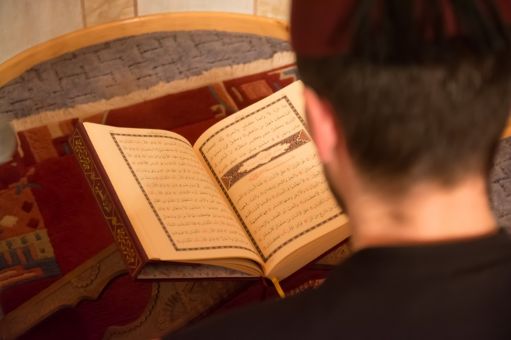 Man reading the Koran