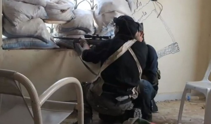 A Syrian rebel sniper in Khan al-Assal, Aleppo province in 2013.