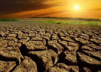 Dry cracked land with sunset in back - Drought Conditions Reach Crisis Levels