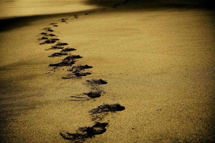 Footprints in sand.