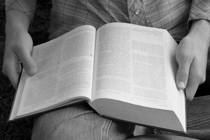 A open Bible on a person's lap.