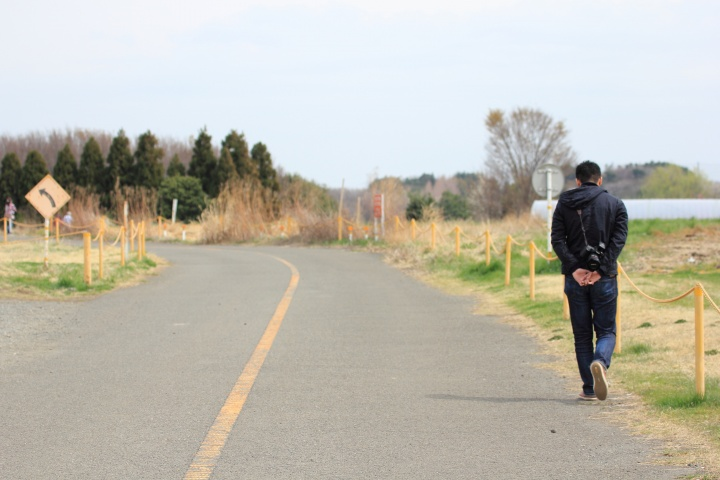 A person walking on a road.