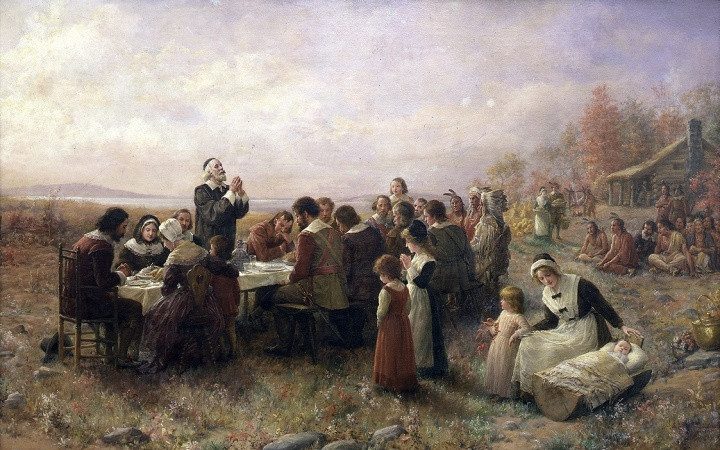 Painting of pilgims giving thanks during a meal.