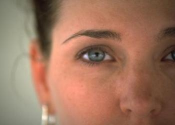 A close up of a woman's face.