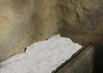 Inside of a tomb showing a white cloth