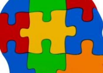 Multi-colored jigsaw puzzle pieces that make shape of human head - Just For Yout
