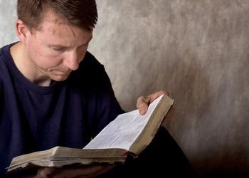 Man reading a Bible.