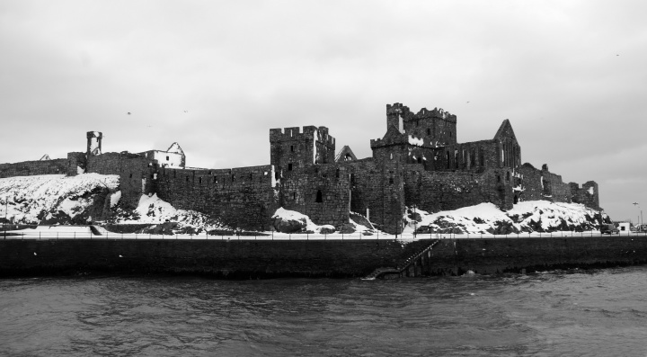 A old castle with broken fortress walls.