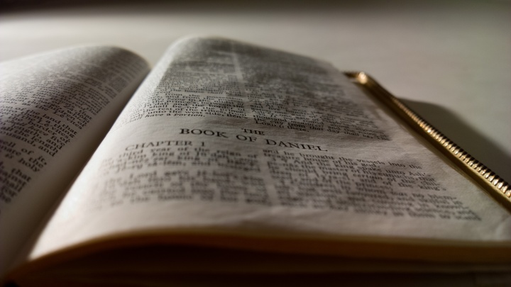A Bible opened the first chapter of the book of Daniel.