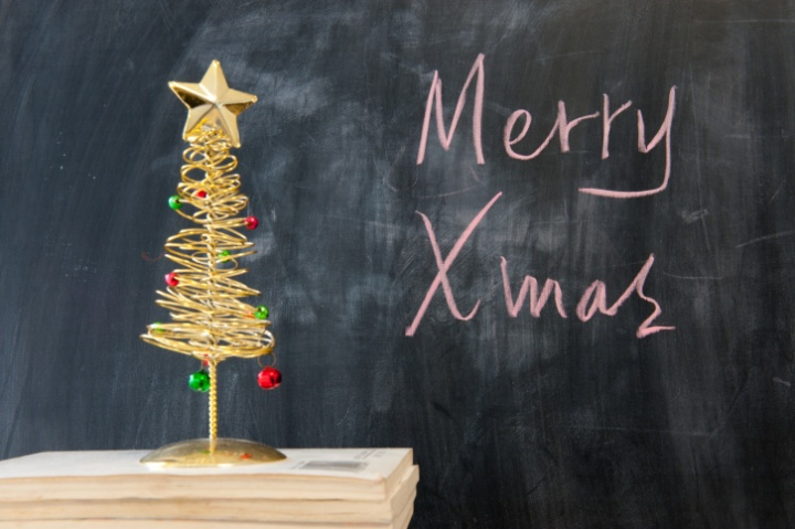 Merry Christmas written on a chalk board.