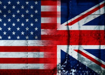 United States and Great Britain flags painted on steel looking background.