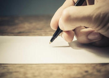 Writing on a paper.
