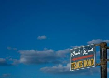 """Sky and road sign """"peace road"""" in english - When Will Peace Come to"""
