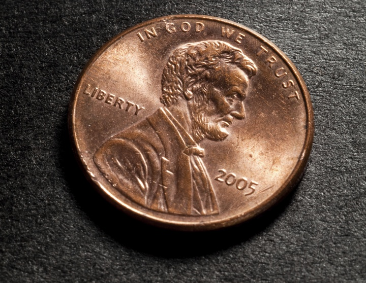 """Front of a penny - with the words """"In God We Trust?"""