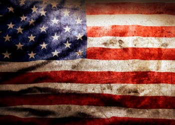 An old weather, stained American flag.