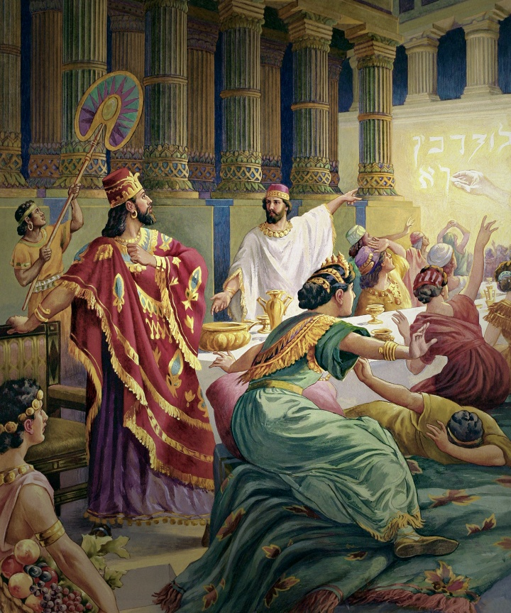 A painting illustrating the writing on the wall of Belshazzar's palace.