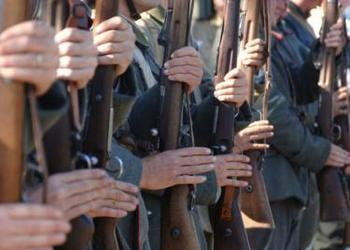 Men holding guns in a row - World News and Trends: New Three-Pronged Axis on the