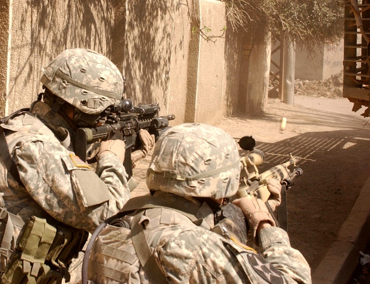 United States troops aiming guns.