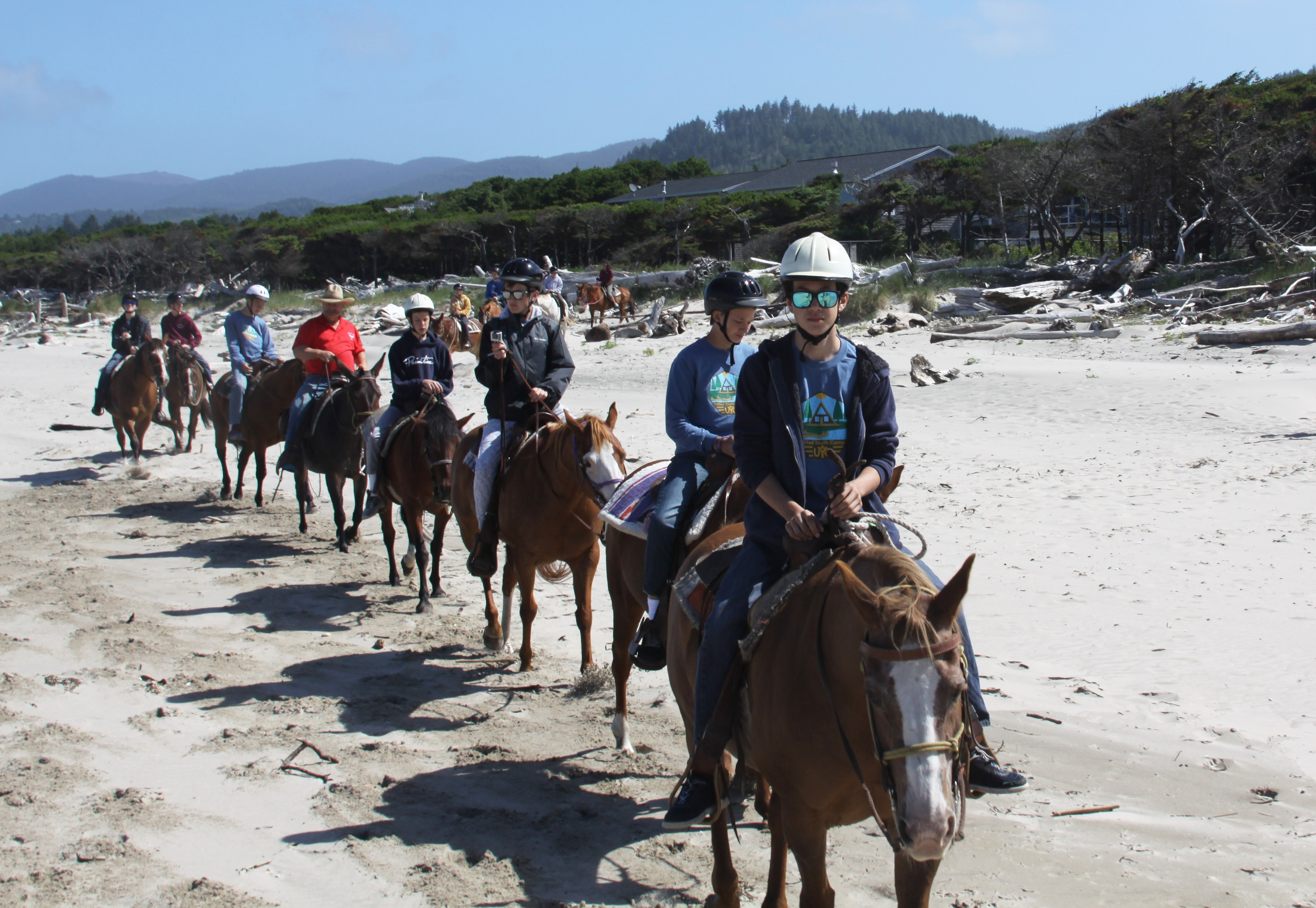 Campers riding horses on the beach at Northwest teen Camp.