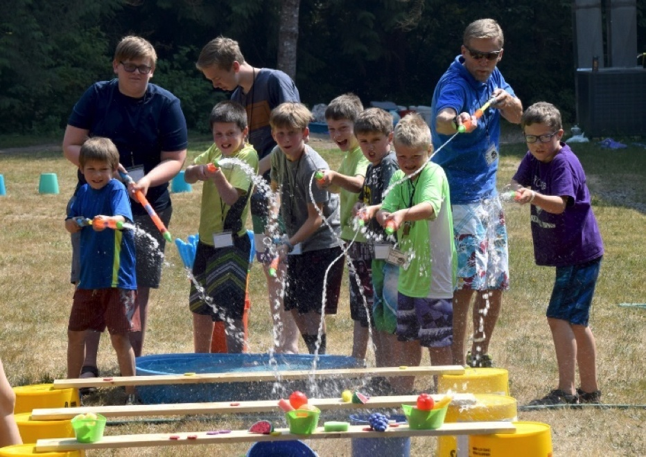Campers and staff enjoying fun activities at Northwest Preteen Camp.