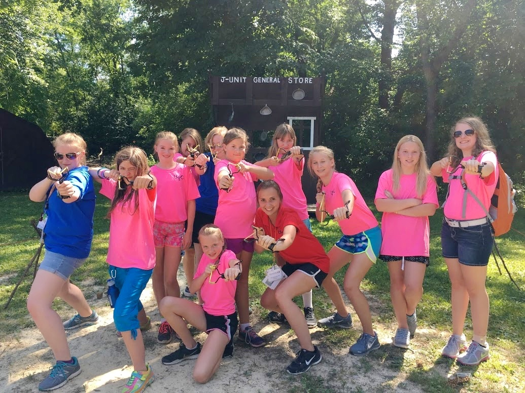 Campers and staff enjoying activities at preteen Camp Ironwood.