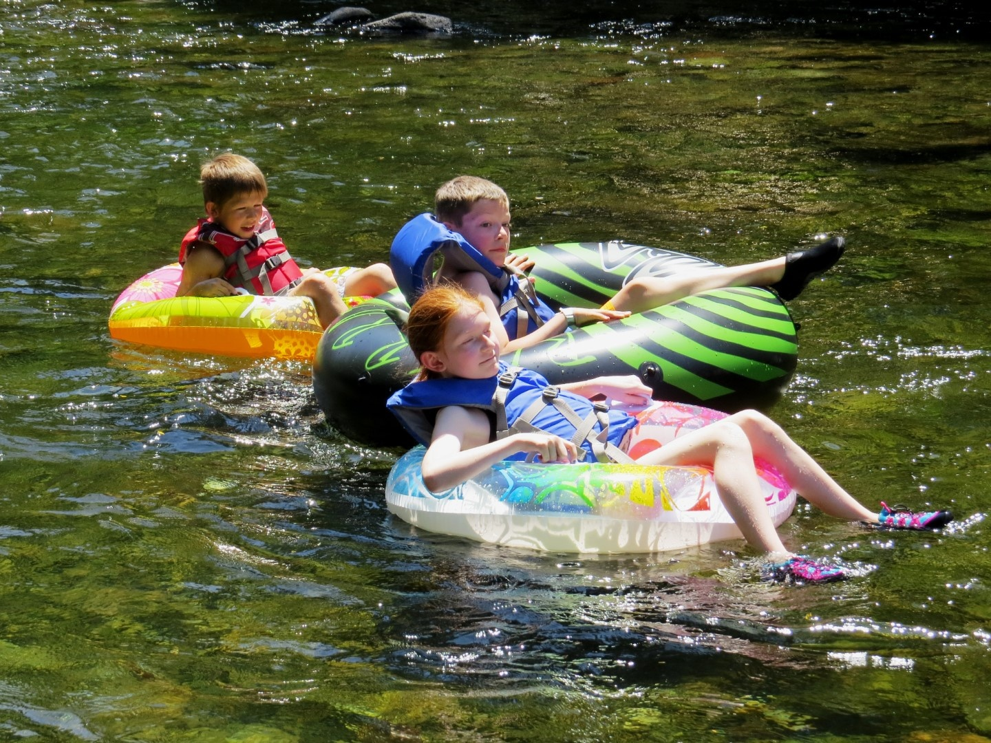Campers on a river float.