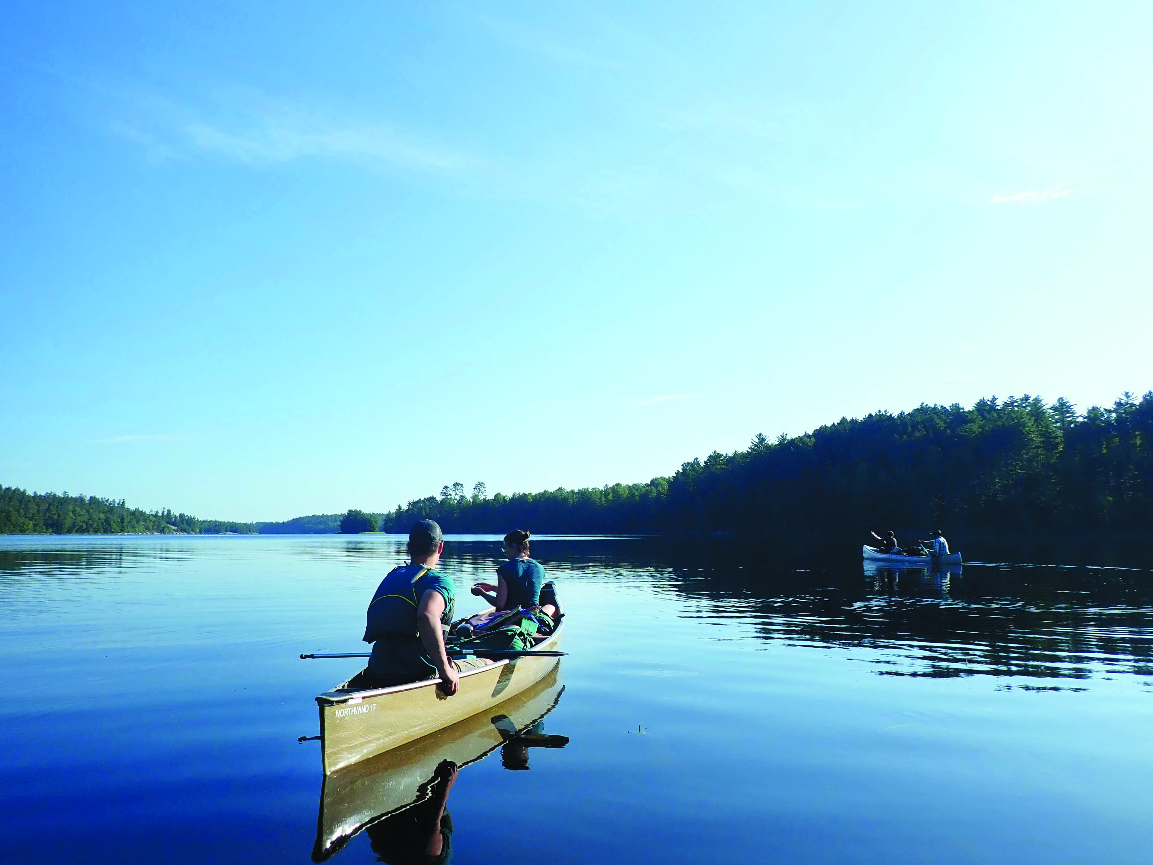 Photo of campers canoeing during the Boundary Waters adventure.