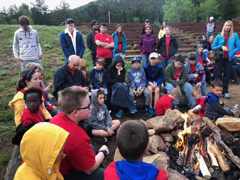 Campers and staff during bonfire time at camp Colorado.