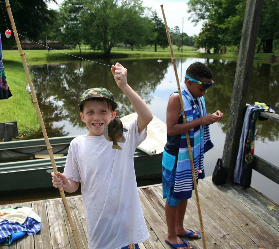 Fishing at Piney Woods preteen camp.