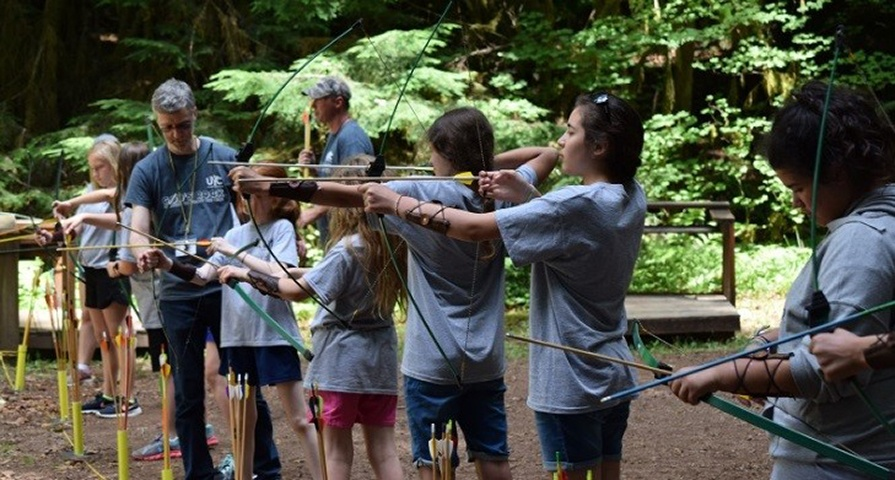 Campers do archery at Northwest preteen camp.