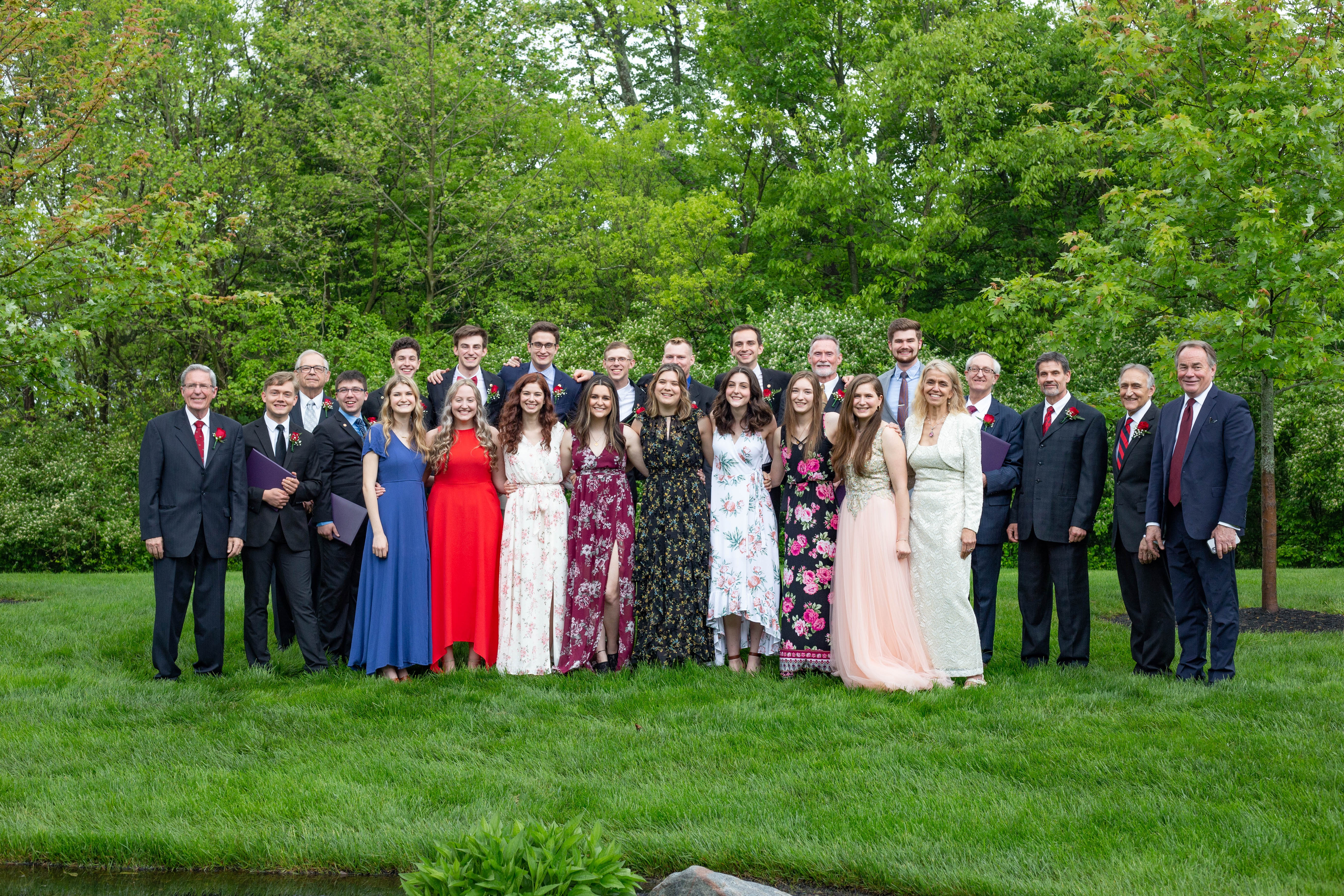 The ABC class of 2021 and faculty members smile after commencement