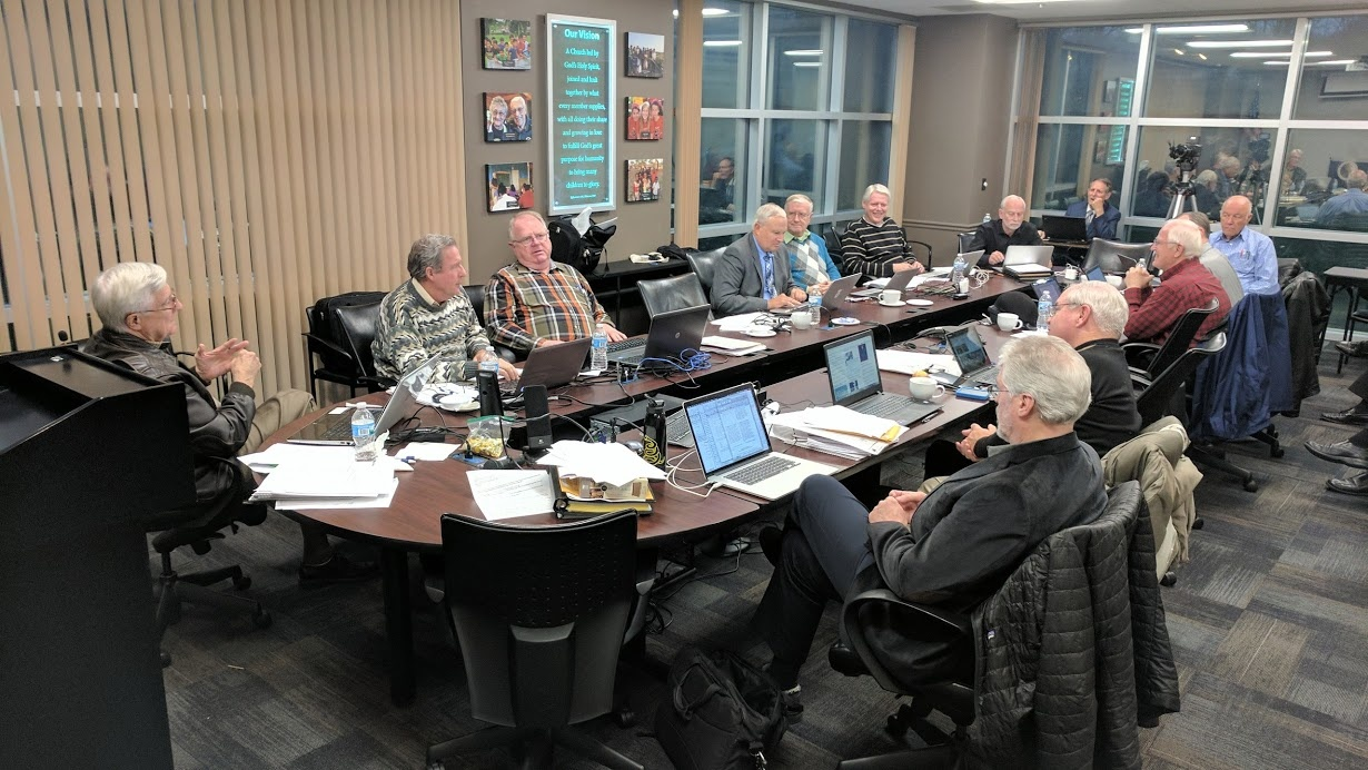 The council of elders meeting at the home office in Ohio.