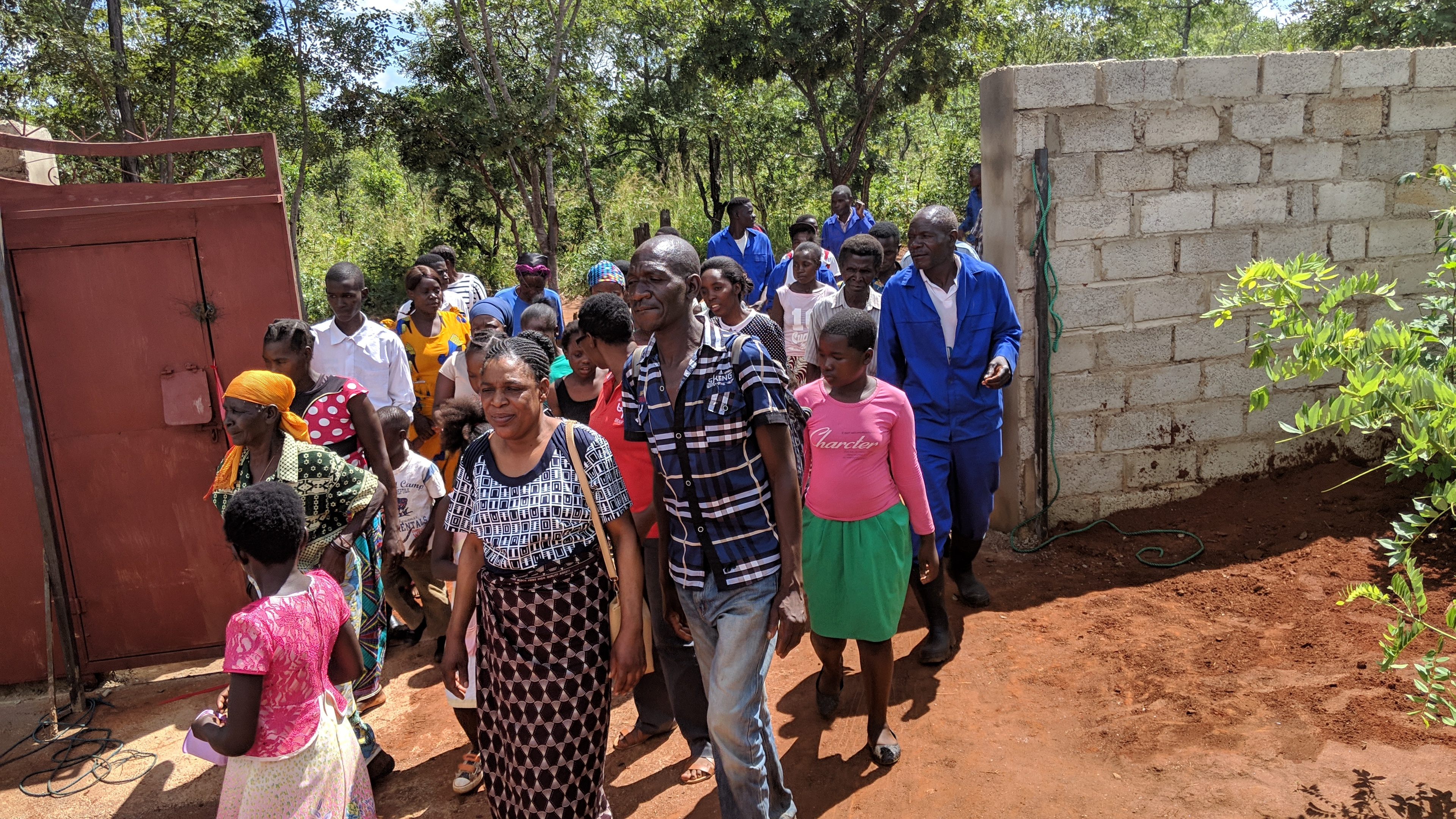 Members enter the church property on the day the wall was dedicated on April 21, 2019.