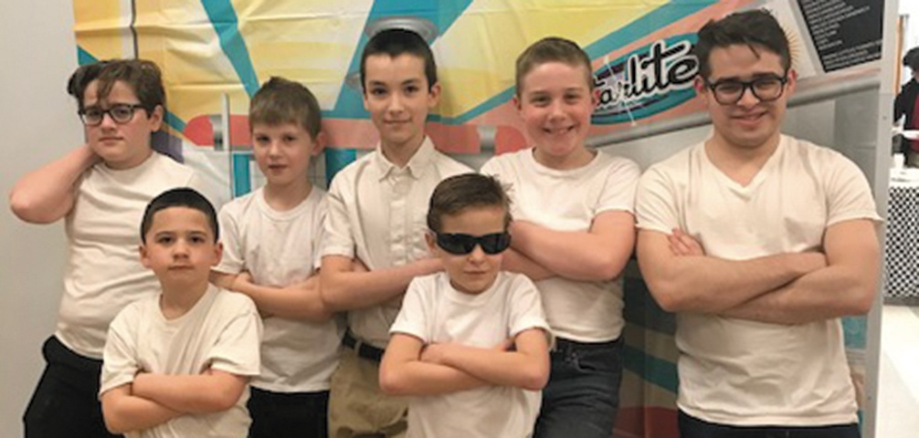 Boys from New England dress as greasers for the dance social on Feb. 1.