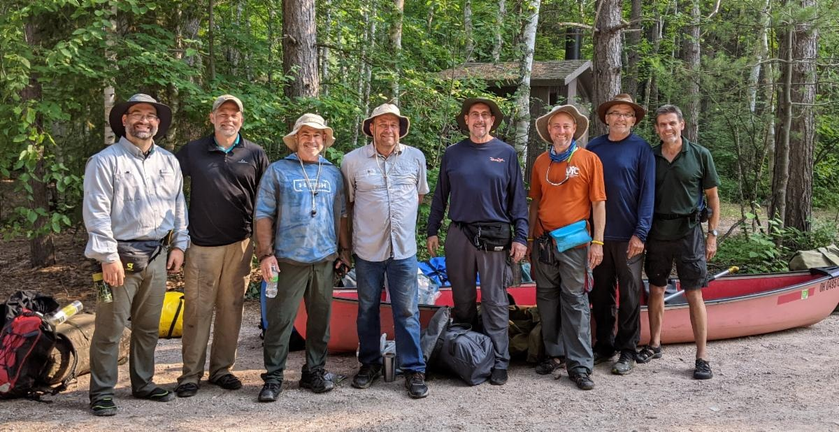 Chris Rowland, Paul Moody, Mark Welch, Michael Fike, Doug Wendt, Jeff Lockhart, Skeets Mez and Frank Dunkle after completing their adventure in the Boundary Waters Canoe Area Wilderness of Minnesota.