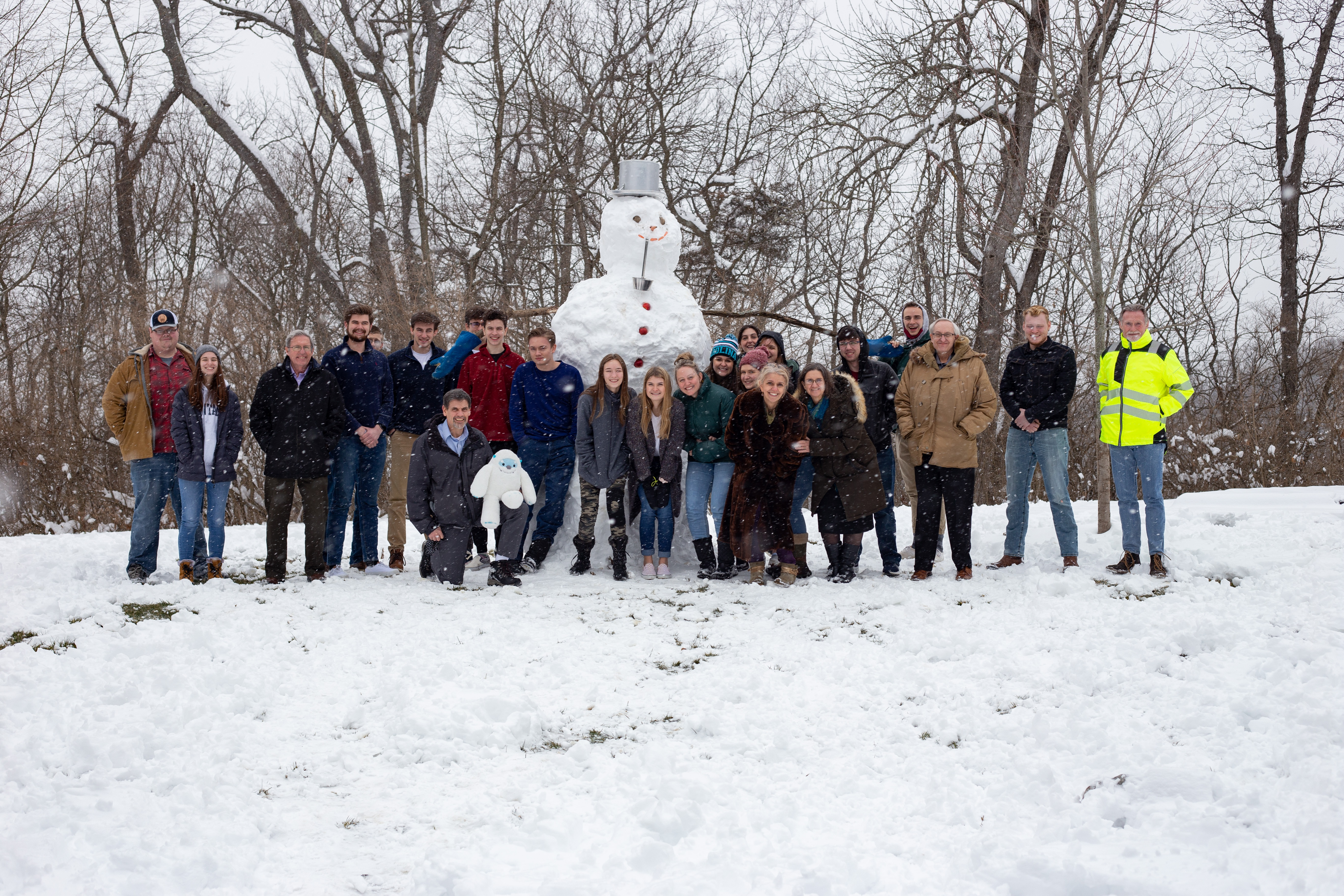ABC students and staff pose with a snowman they made on Feb. 9.