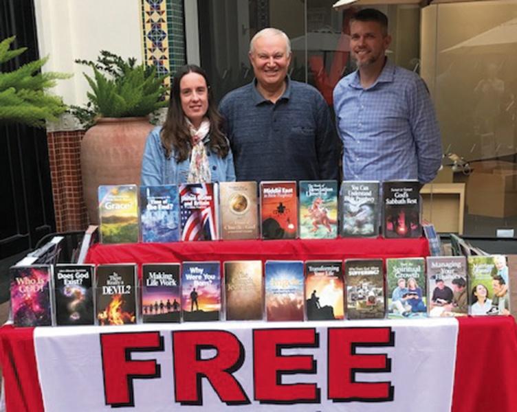 Jennifer Heesch, Mario Seiglie and Bill Carter at the newsstand at Irvine Spectrum Mall.