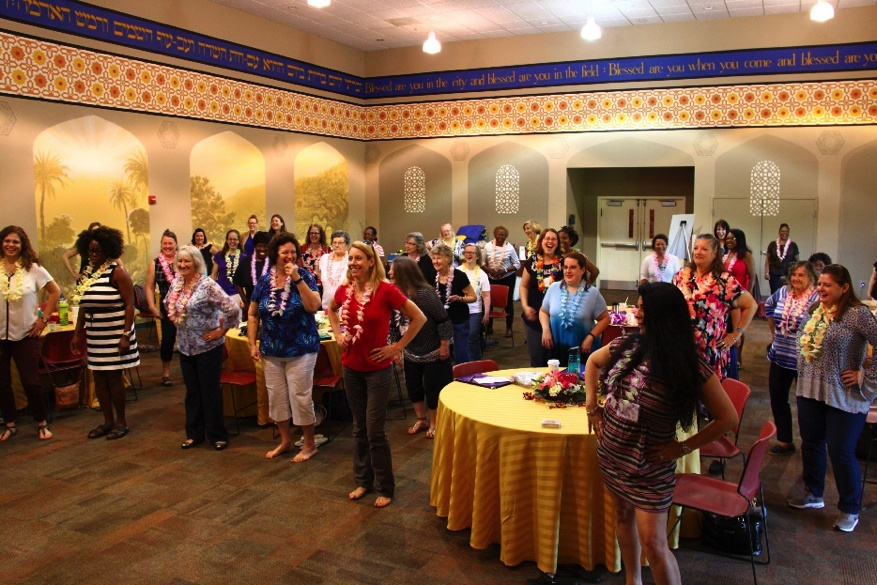 Women learning to hoola dance at the Mid-Atlantic Women's Enrichment Weekend in Reisterstown, Maryland.