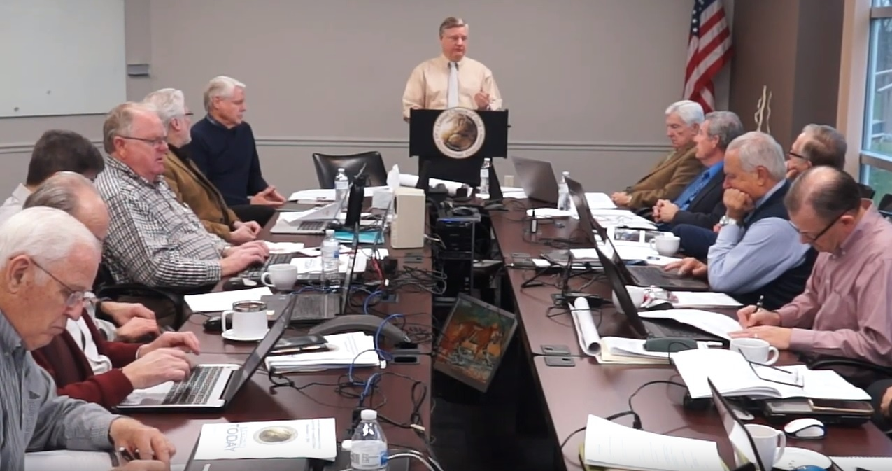 Peter Eddington presents a report to the Council of Elders at their December meeting.