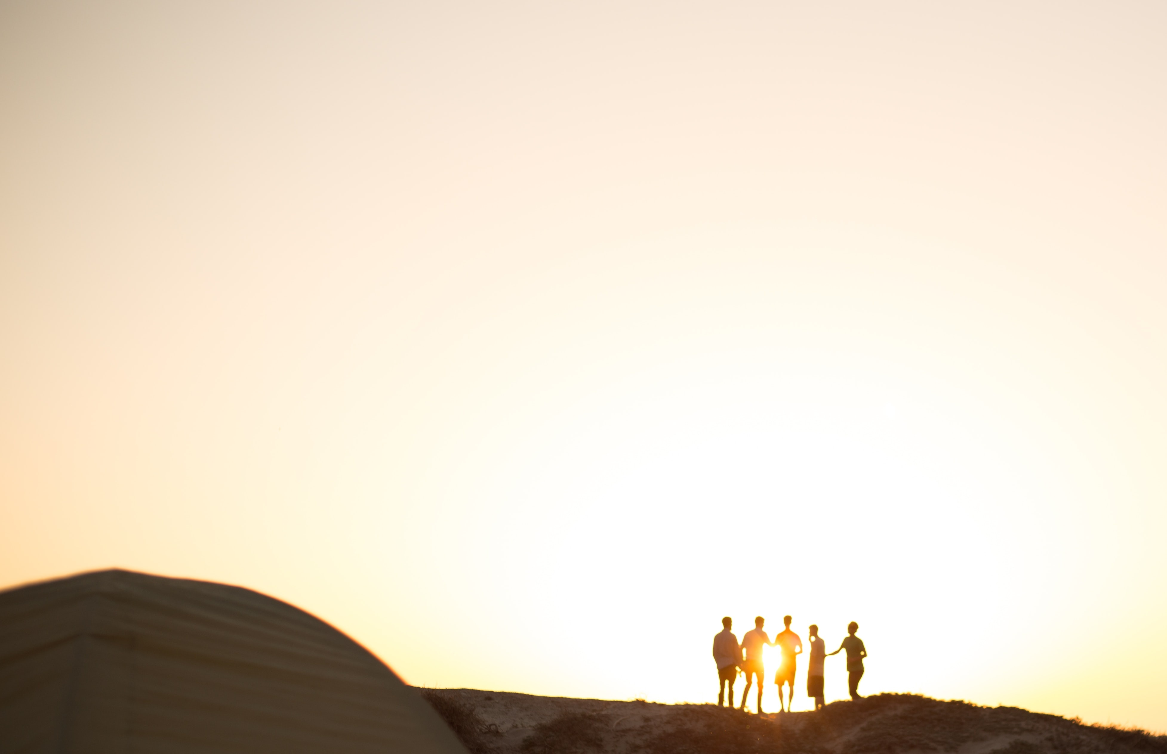 Photo of people's silhouettes at golden hour.