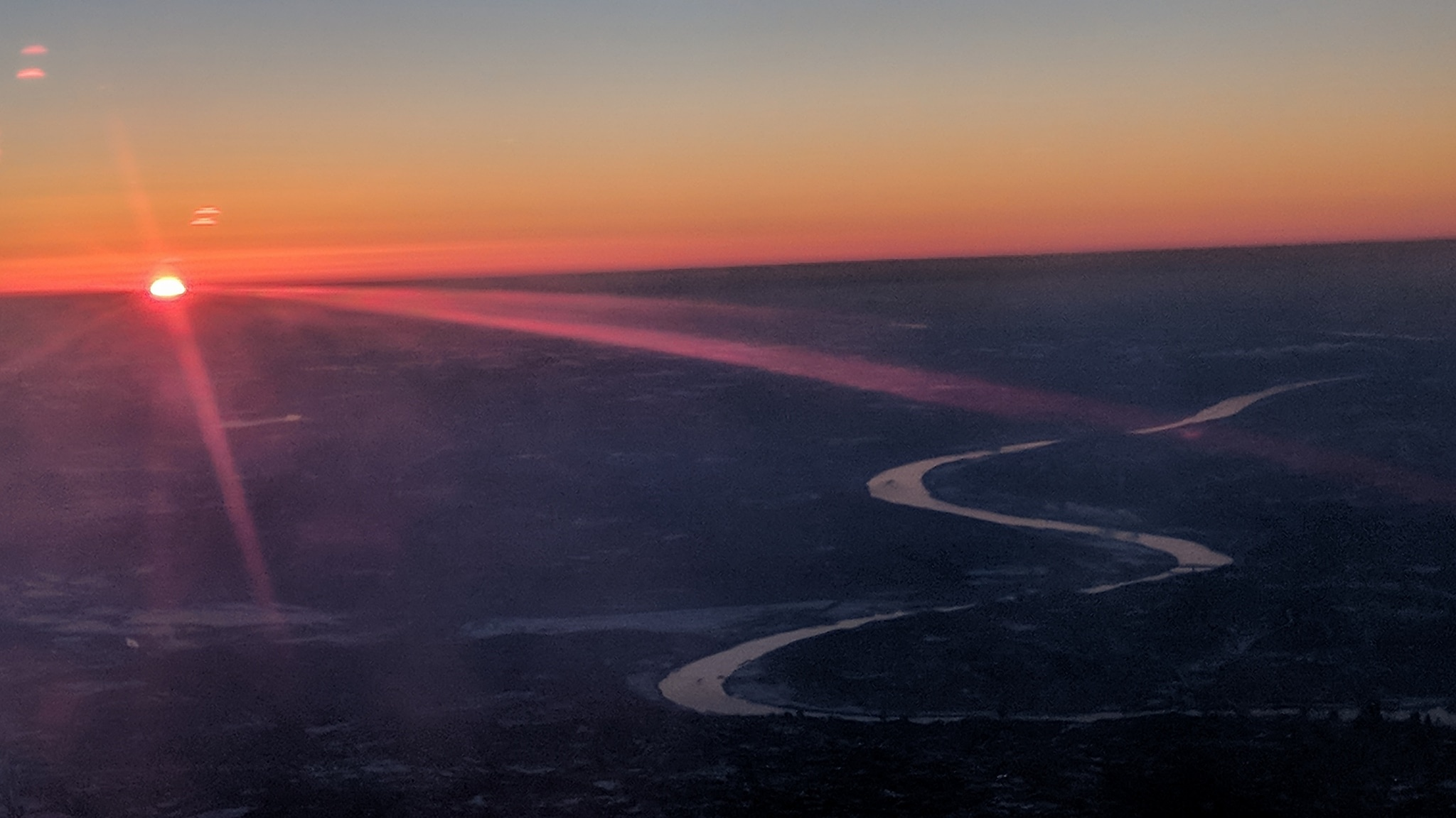 Sunset over Cincinnati as Mr. Kubik takes off from the airport.
