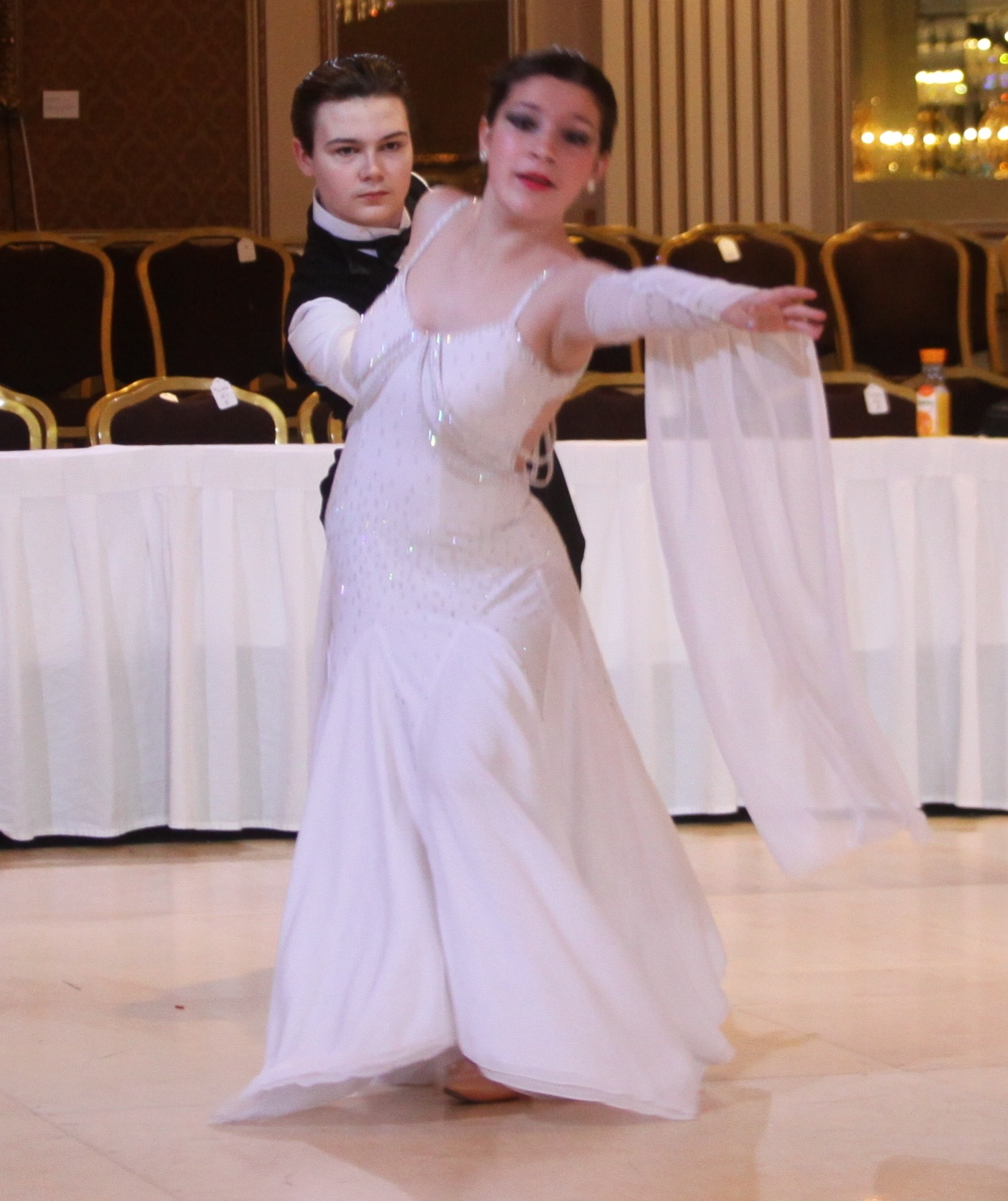 Alexander Schweitzer, grandson of members Jim and Shirley Buckmaster of Milwaukee, with his dance partner Harmony Kaegi at a state-level dance competition.