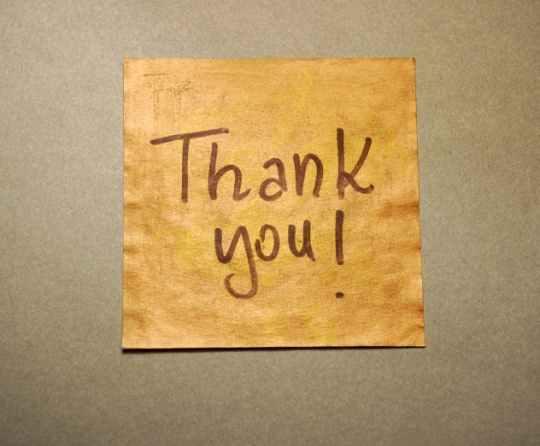 Thank you! written on brown paper.